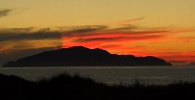 Sunset of Kapiti Island, by Jondaar Jondaar  This special photo is in the April 2012 digital photo contest on New Zealand vacations.