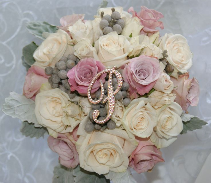 """2"""" Bridesmaids Pin enhancing this beautiful bouquet by Berries and Blooms."""