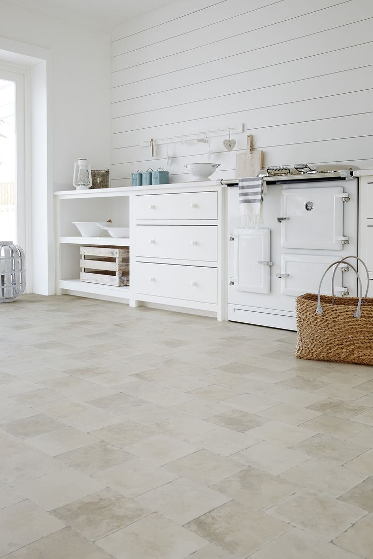 We love this all-white scheme, featuring Stonemark Lucca underfoot. www.leoline.co.uk