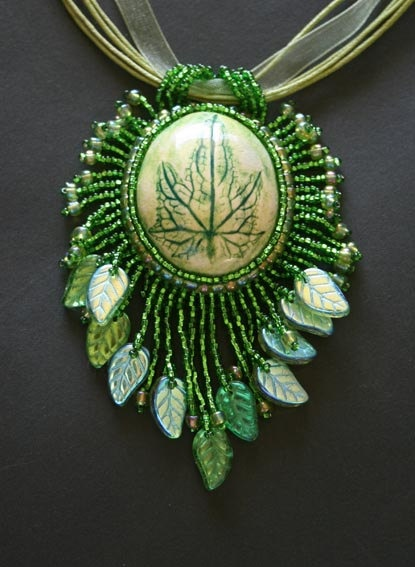Evergreen bead embroidered leaf pendant by marynikydesigns