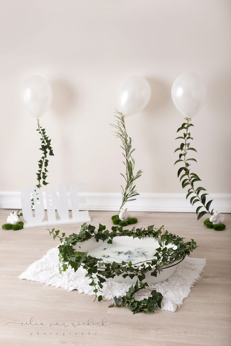"""We just had to share the cuteness with you! White balloons with Greenery strings, small white bunnies carefully placed on patches of moss, """"ONE"""" laser cut-out and an Ivy leave crown for the sweetest little guy. Pronkertjie Flower & Décor Styling and Celia van Niekerk Photography"""