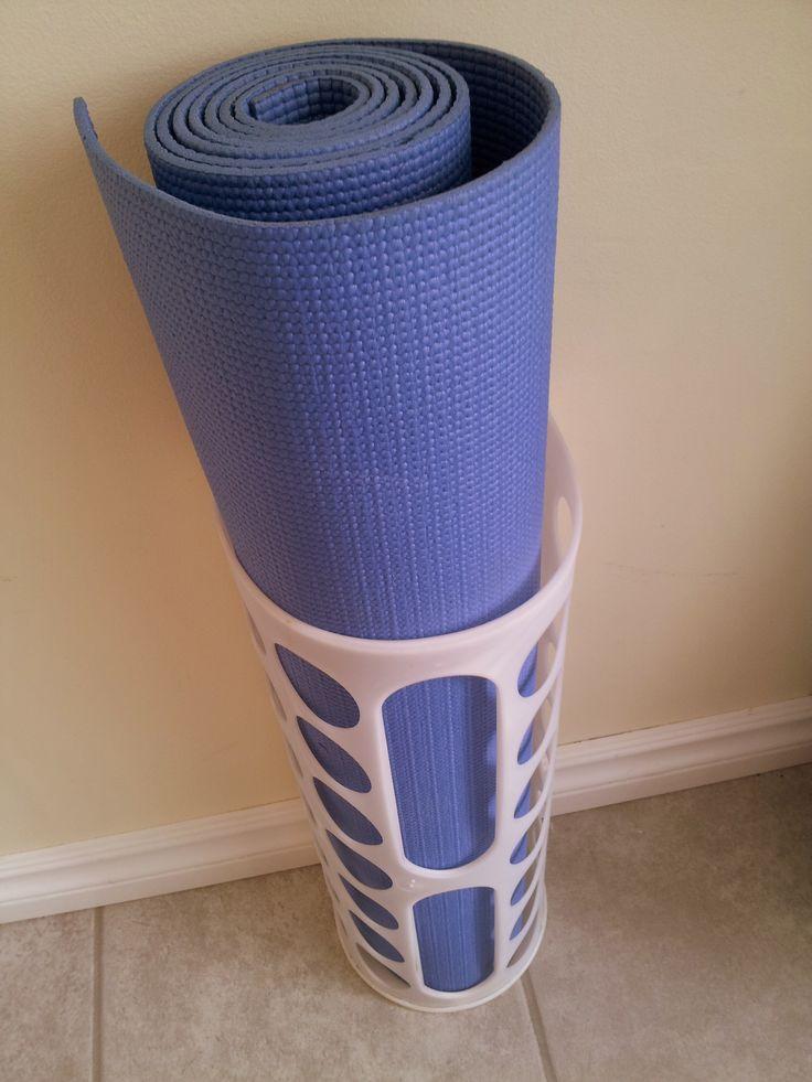 A $3 IKEA VARIERA plastic bag dispenser makes for excellent yoga mat storage.