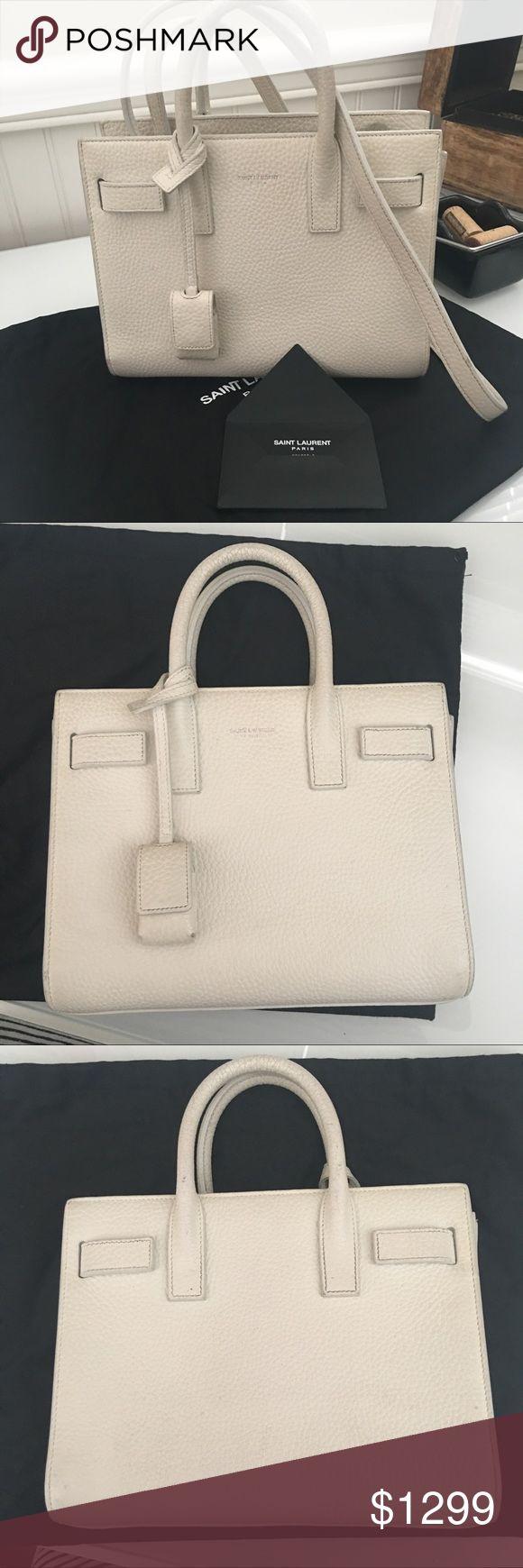 "SAINT LAURENT Nano Sac De Jour Bag SAINT LAURENT Nano Sac De Jour Bag in White. Grained calfskin leather with grosgrain lining and silver tone hardware. Made in Italy. Detachable shoulder strap. Measures 8.5""W x 7""H x 4.25""D. Excellent condition, comes with dust bag and bag number. Saint Laurent Bags Crossbody Bags"