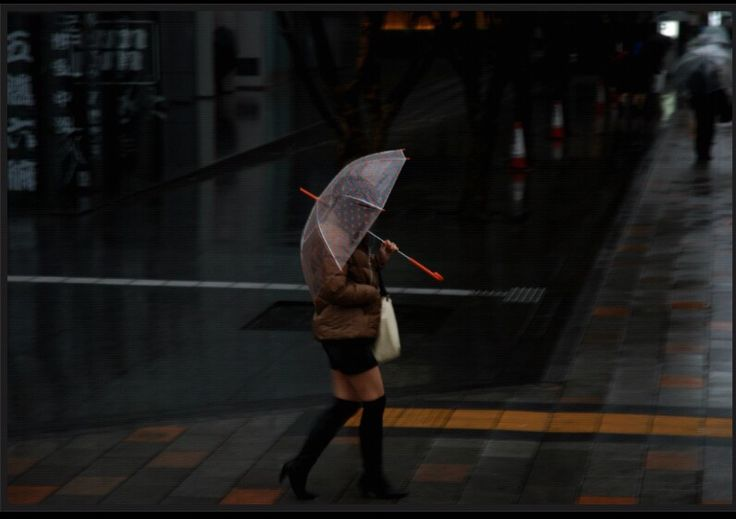 A lady in the rain