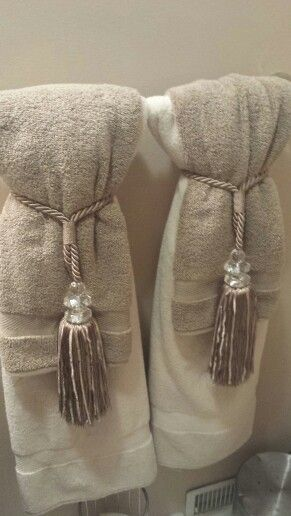 Tia's Tip: A gorgeous, yet inexpensive way to dress up a bathroom is using curtain tie-backs for the towel display. I get tons of compliments on this simple idea!