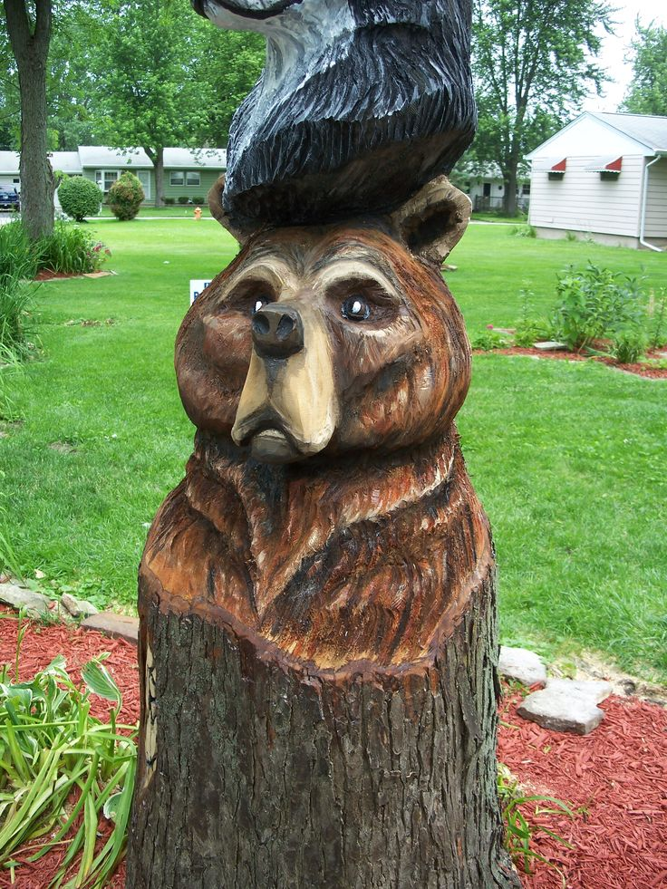 Bear wood carving in totem pole painted by audra kohut
