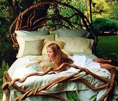 Rustic bed made with grapevine.  I love this and want to make one!