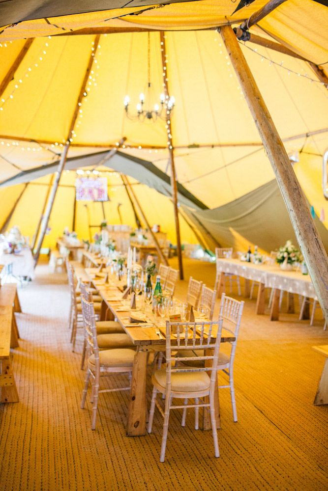 "Ellie and Ed wanted their June wedding to not only reflect them - their likes and loves - but to be a fun day for everyone, full of DIY details. The day started with an emotional ceremony at Aldenham School, Elstree and the reception was in tipis on Buckettsland Farm, Well End. ""We said the whole way through the planning process that we didn't have a theme but looking back it was essentially junk and glitter"", began the bride. ""If you ever saw our flat, you would know that we're not…"