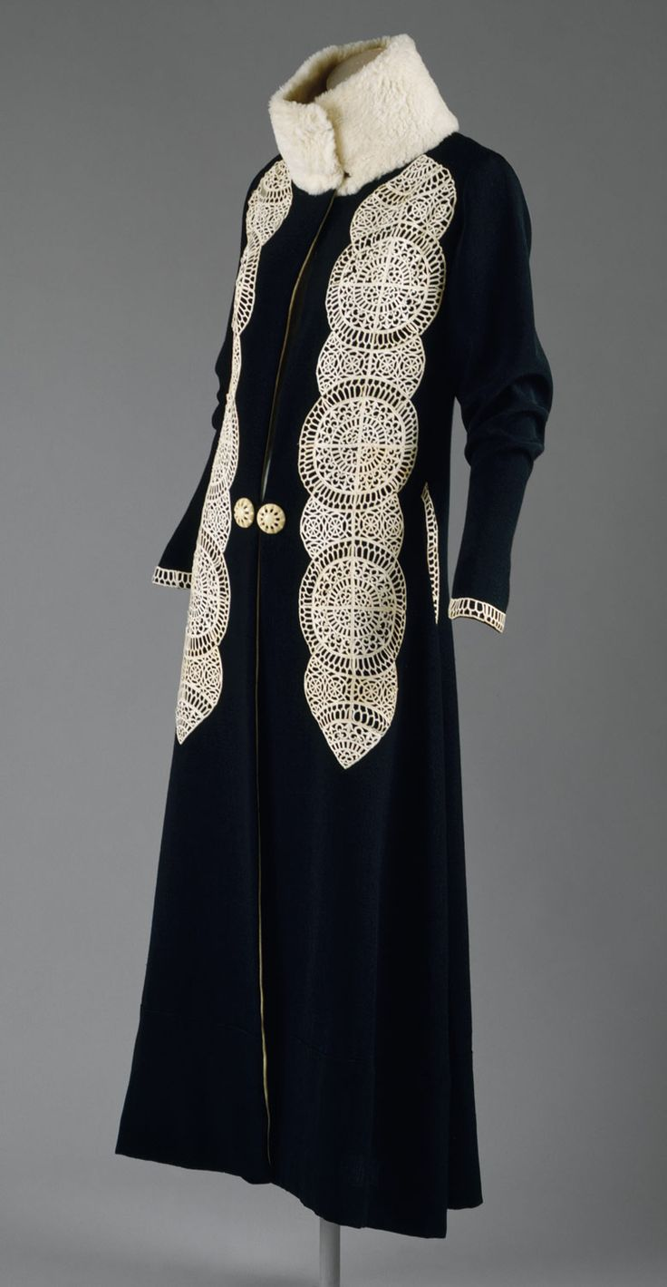 Designer: Paul Poiret (French, Paris 1879–1944 Paris) Date: ca. 1919 Culture: French Medium: silk, wool, fur, leather  Poiret introduced an avant-garde sensibility into couture. His penchant for opulent gestures, lush fabrics, fur, and feathers was part of his grandiose Gesamtkunstwerk, inspired by stage and Orientalist extravaganza. He was also capable of more subdued garments. In the case of this day coat, the leather of the appliqués is cut into delicate filigree and couched by hand onto