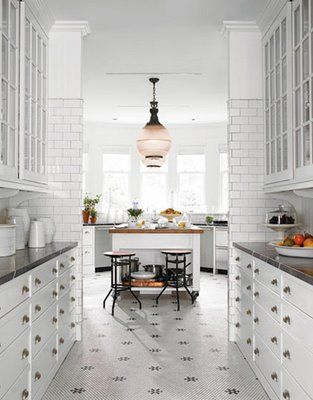 I like the traditional pass-through design of this bulter's pantry. Ideally the butler's pantry connects the kitchen to the dining room, provides a place to store serving dishes and linens and creates a natural station for serving prep.