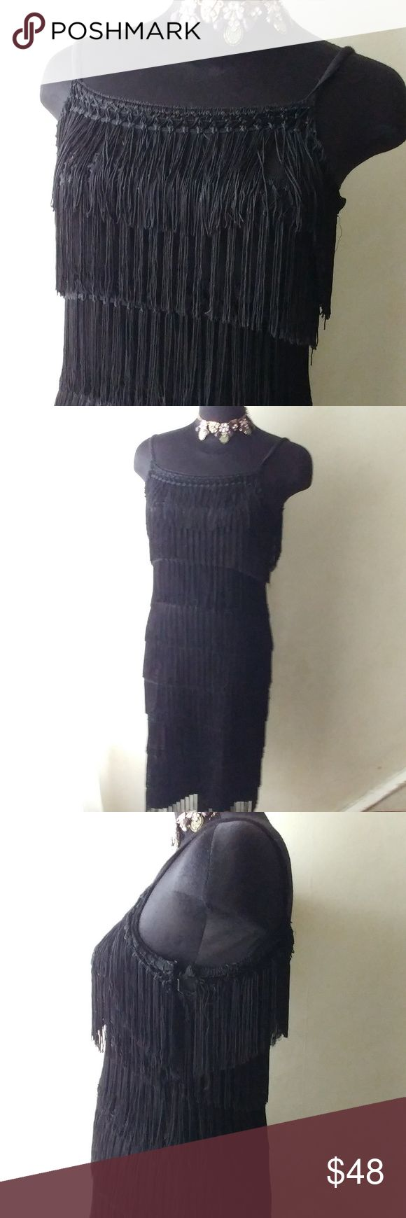 Nina Leonard Sexy Shingled Little Black Dress Perfect condition.  No signs of wear. Absolute stunner. All shingles are intact. Movement with each step. Acrylic wool blend.  Very nice weight and stretch on this piece. Side zip, 18 inches pit to pit, 42 inches in length (including straps) Size says small however mannequin fits 8/10. Nice stretch with perfect structure and memory in fabric. Perfect piece to get noticed in. Don't miss out. Nina Leonard Dresses Midi