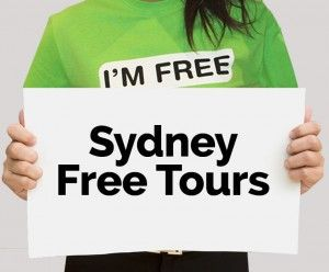I'm Free Tours Sydney guide holding a sign. Click to find out more about Sydney tours