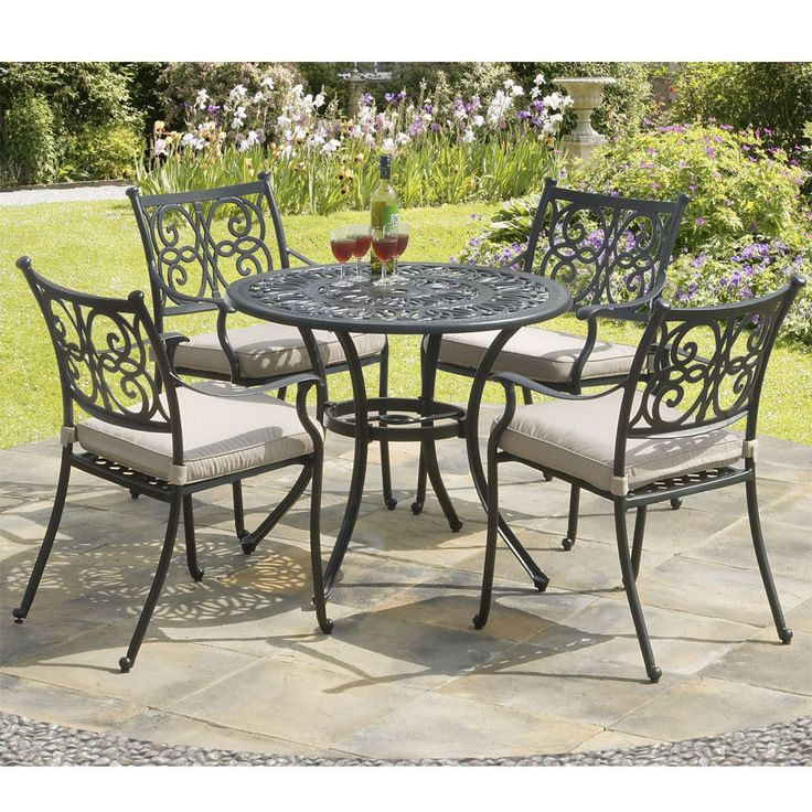 Our superbly styled Guildford 4 Seat Cast Aluminium Garden Dining Set is designed to combine elegance with comfort and durability. Cast in solid matt black coated aluminium, the dining armchairs have elegant contours, beautifully scrolled casting details and are finished with ball finials and feet with surface protectors. Generous removeable, beige seat pads give additional comfort. The table seats four comfortably and has an attractive filigree style solid cast top with a parasol hole.<BR…