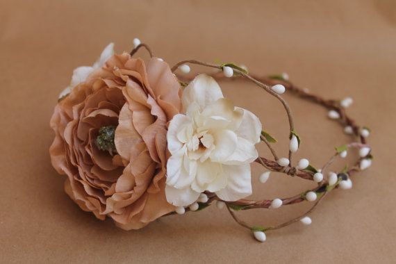 This stunning and romantic flower crown features a large high-quality peony paired with white delphiniums and peach blossoms on a twisted pip berry