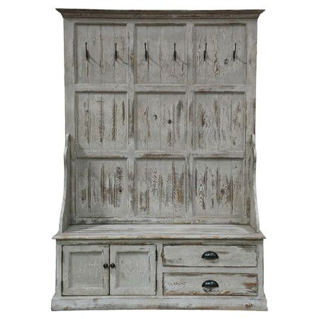 Crafted of reclaimed pine wood and featuring bench storage and 6 hooks for coats and hats, this rustic hall tree welcomes guests in your foyer or mudroom.