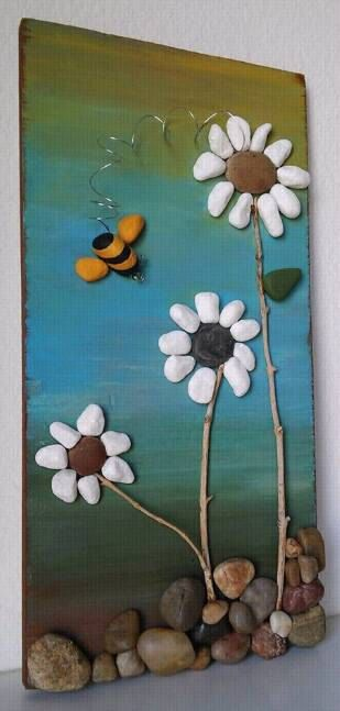 Pebble Art / Rock Art Flowers with a flying bumble bee on reclaimed wood…
