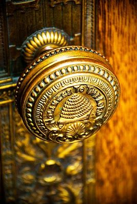 """""""Holiness to the Lord"""" and bee skep on this beautiful door knob embellishing a solid oak door."""