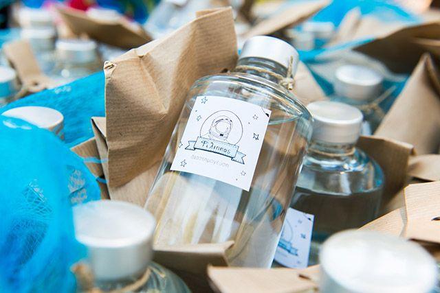 Little Filippos' baptism. Gifts for adults. Space drink. A bottle with cretan raki.  Designed by www.skafandro.gr
