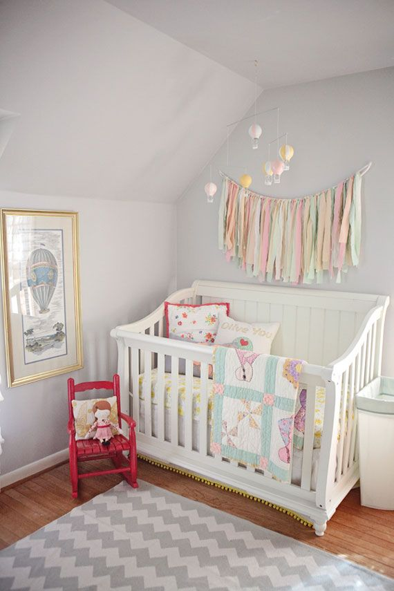 Handmade Nursery. Ribbon banner, quilt, red, yellow, gray, and pinks, so lovely.