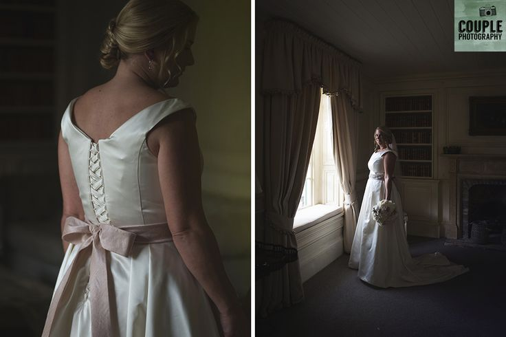 The bride wearing her gorgeous wedding dress with dusty pink bow. Weddings at Cliff At Lyons by Couple Photography.