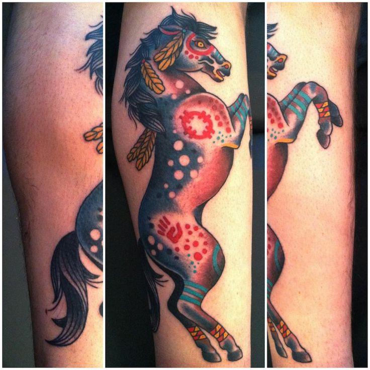 http://www.seawolftattoocompany.com/wp-content/uploads/sites/2/2013/07/native-war-pony-tattoo-web.jpg for my calf