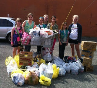 Girl Scouts Donate Cookies, Food to Local Charity