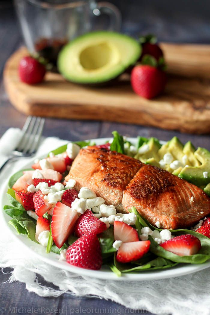 Pan seared salmon with strawberry avocado salad with goat cheese and maple balsamic reduction