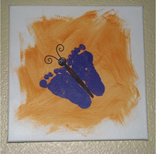 Adorable little footprints. A butterfly footprint craft. So easy!