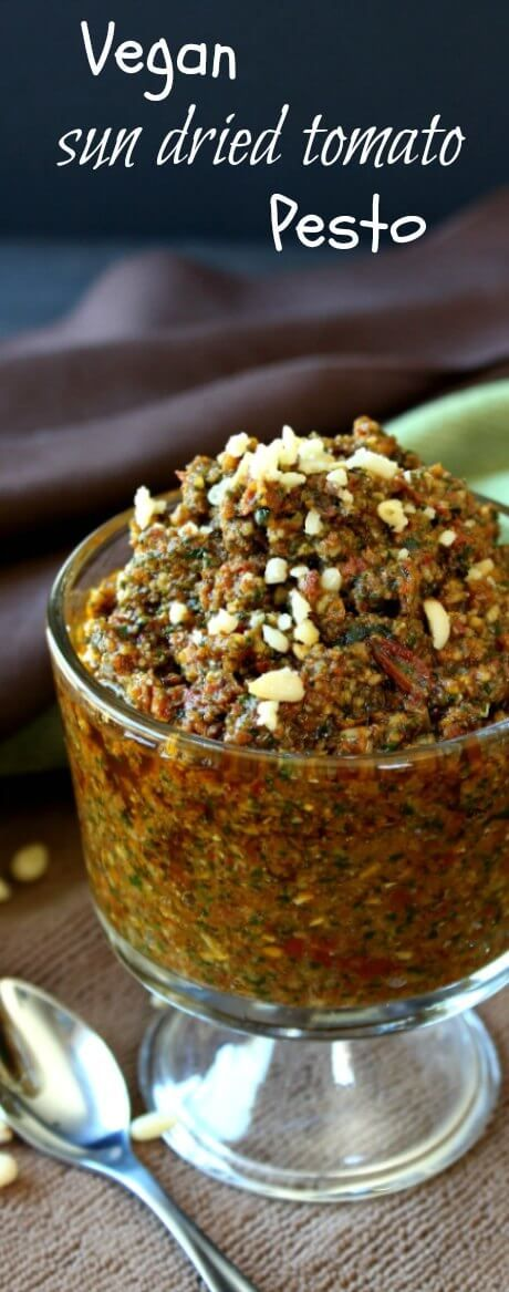 Vegan Sun Dried Tomato Pesto is flavorful, versatile and can be made in under 10 minutes.  Make some as a condiment or freeze little cubes for future meals.