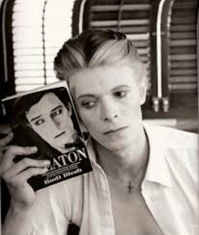 "David Bowie holding Blesh bio ""Keaton"" - 1975"