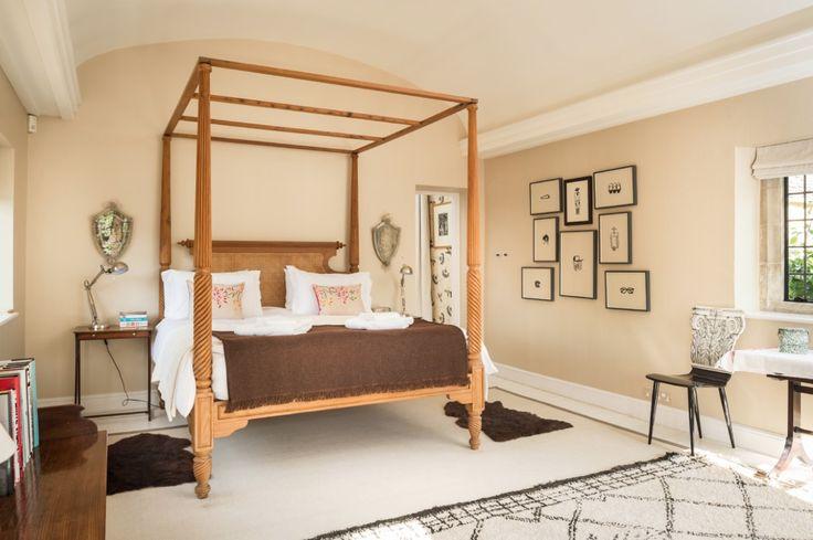 Master bedroom cream walls wooden side tables black framed art