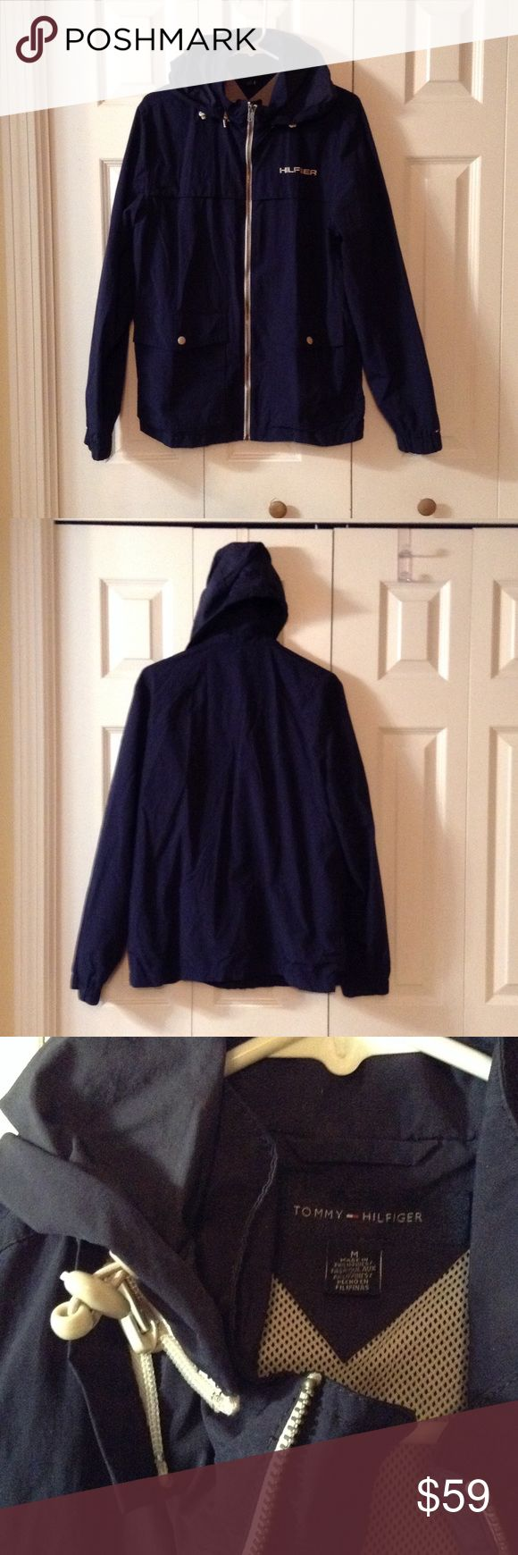 Tommy Hilfiger Men's Water Resistant Windbreaker Tommy Hilfiger Men's Full-zip Water Resistant Yacht  Windbreaker Jacket. Fold away hood, snap closure front pockets, mesh interior.  Color: Navy Blue. Excellent condition. Tommy Hilfiger Jackets & Coats Windbreakers