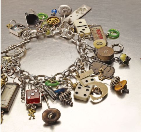"GREAT IDEA!  Collect game pieces from Thrift Store board games. Industrial Chic™ Games People Play Bracelet. This charm bracelet took inspiration from the original one of a kind piece, ""Games People Play"" by Susan Lenart Kazmer. Designed by Designers from Horizon Group USA - Susan is the best, most FUN jewelry instructor - ever #bracelet #charm #Susan Lenart Kazmer"