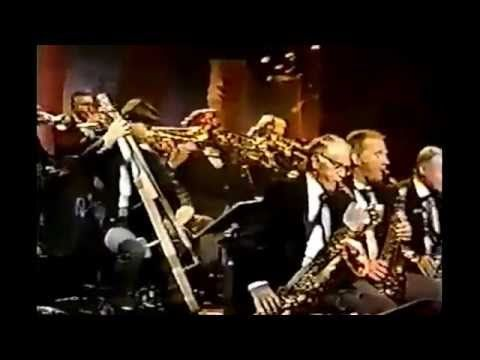 About two months after Johnny Carson said goodbye to the Tonight Show, Doc Severinsen brought the band to the Arsenio Hall Show. Here's one of the great Coun...