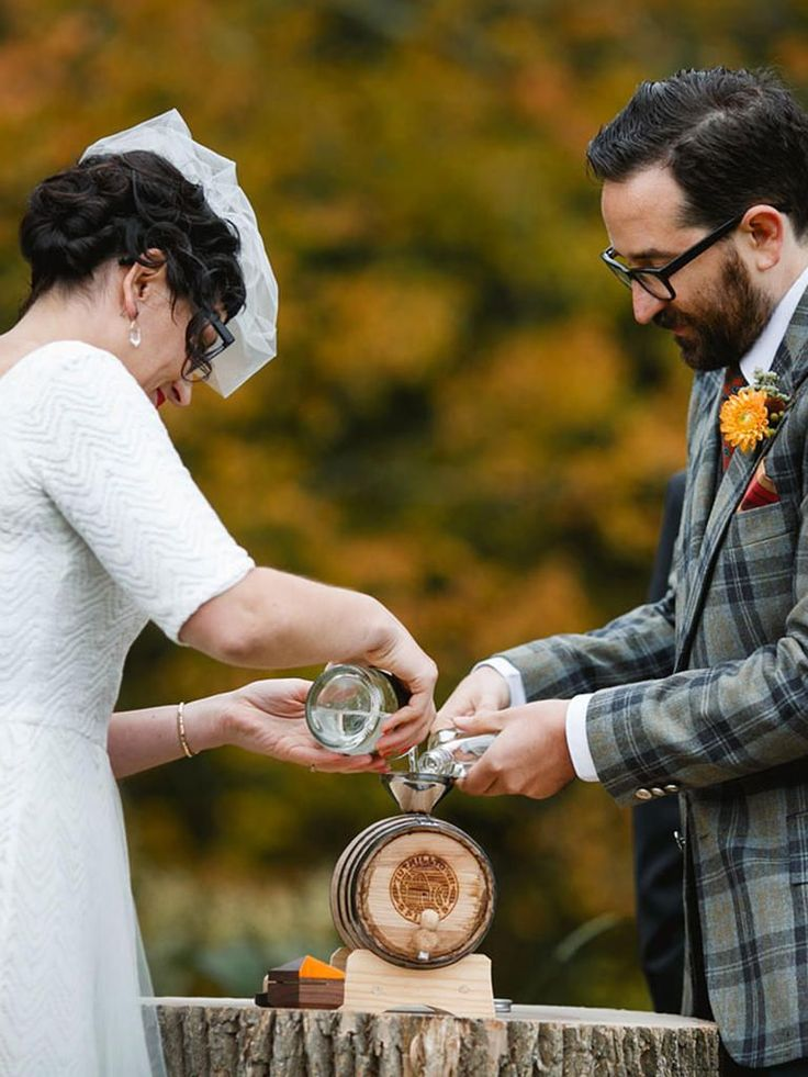 Age your own wedding-day spirit in a barrel that's branded with your new monogram, like this couple did. They poured unaged corn whiskeys from upstate New York and Brooklyn into a two-liter barrel as an alternative unity ceremony.