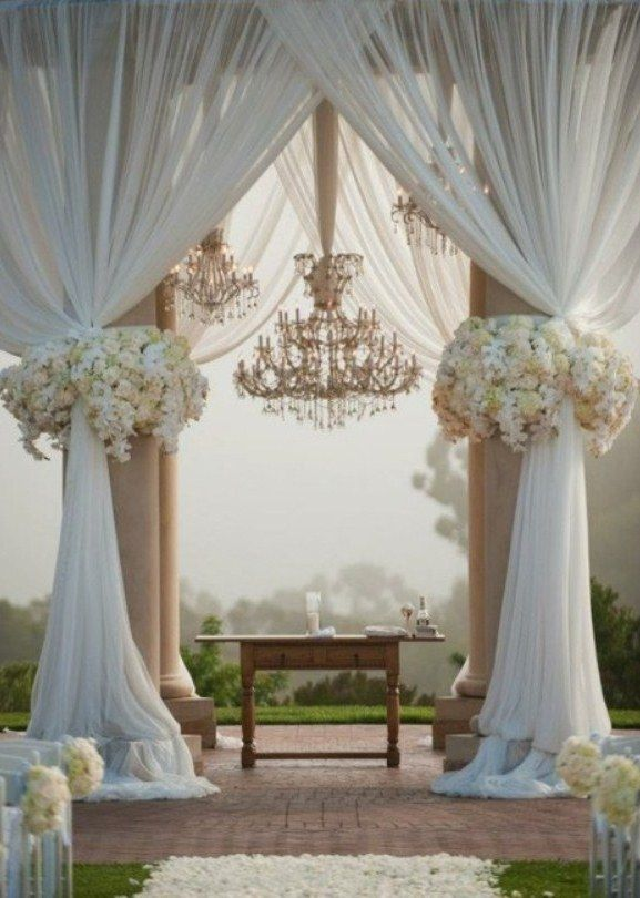 Gorgeous canopy with chandeliers and large floral accents.