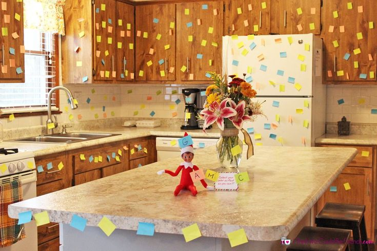 This is another EASY Elf on the Shelf idea (and was fun to do!) but made a BIG impact when the kids saw it! And it was super fun for them to race around collecting their color of post it note (not even realizing that they were cleaning it all up for us!).