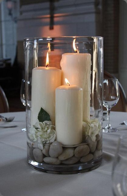large hurricane vase with candles, rocks and gardenias – centerpiece – bjl