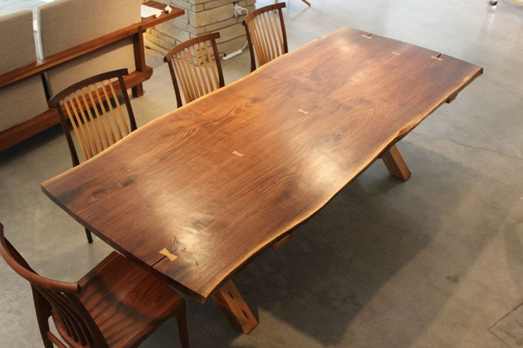 Saw Buck Table by Fred Savage.  A traditional country style hand-crafted table evoking an earlier era and simpler life.  Available at Kozai Modern  $7,600
