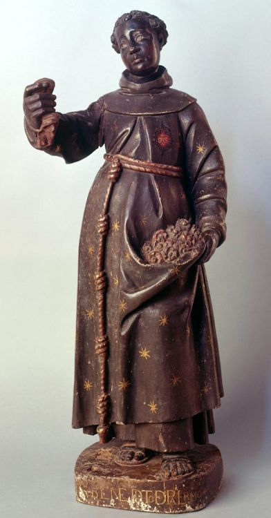"""medievalpoc: """" Anonymous Portuguese Artist Saint Benedict of Palermo with Flowers and Cloth Portugal (c. 1680s) Polychrome and Gilded Wood, 87 cm. Obidos, Igreja Paroquial de São Pedro. Standing figure of St. Benedict of Palermo in Franciscan habit..."""