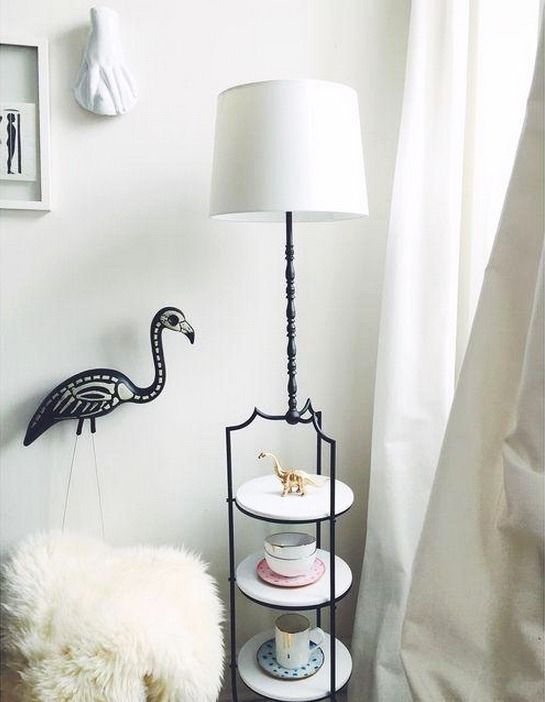 This refinished sleek dual purpose floor lamp/side table will add a unique touch to any setting. The flat black paint compliments the glossy white shelves giving this piece an updated look.