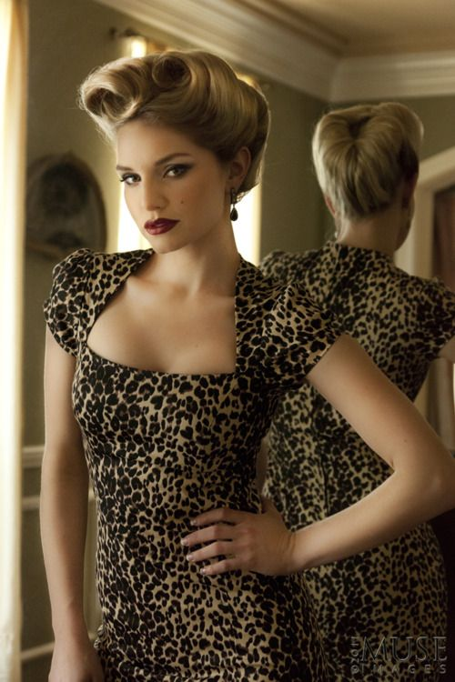 not typically a fan of animal print, but this is awesome! not to mention the retro pinup curls!