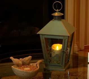 create a warm and inviting nook indoors or out with this luminara candle lantern