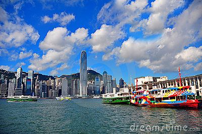 A look at the star ferry located at tsim sha tsui, kowloon island and the hong kong island in the background