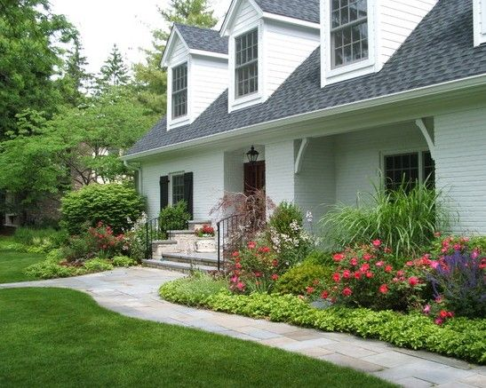 Landscape front yard border plant by driveway for Front garden and driveway designs