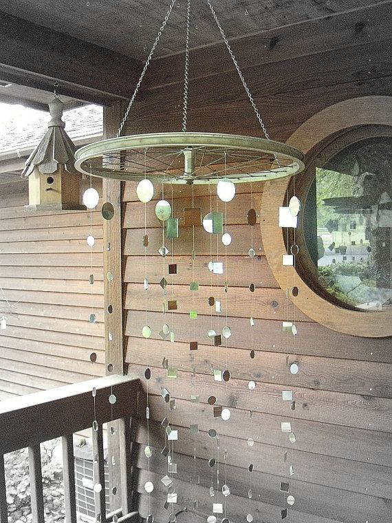 Recycled Bicycle Wheel with Mirror Garland. This could be interesting hanging from a tree, maybe as ceremony bakdrop?