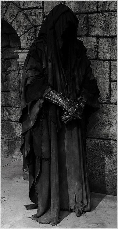 """""""They were once men; great kings of men. Then Sauron the deceiver gave to them nine rings of power. Blinded by their greed, they took them without question, one by one falling into darkness. Now they are slaves to his will. They are the Nazgul, Ringwraiths, neither living nor dead. At all times they feel the presence of the Ring, drawn to the power of the One."""""""