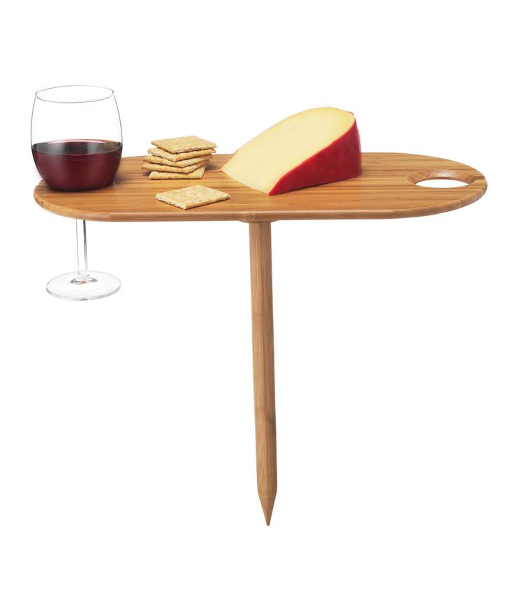 Table For Two  Warning: Enjoying wine in a beautiful park or on a warm beach while watching the sunset will increase pleasure, charming conversation and/or romance by 100%.  Take wine to your favorite locales without having to worry about spills with this genius bamboo wine table. Designed to work with any stemmed wine or champagne glass, this table sticks directly into the ground or sand and holds glasses steady, plus has a small surface for a light snack. $22