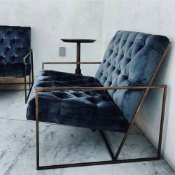 Inky blue velvet against angular brass frame chair vilde kaniner
