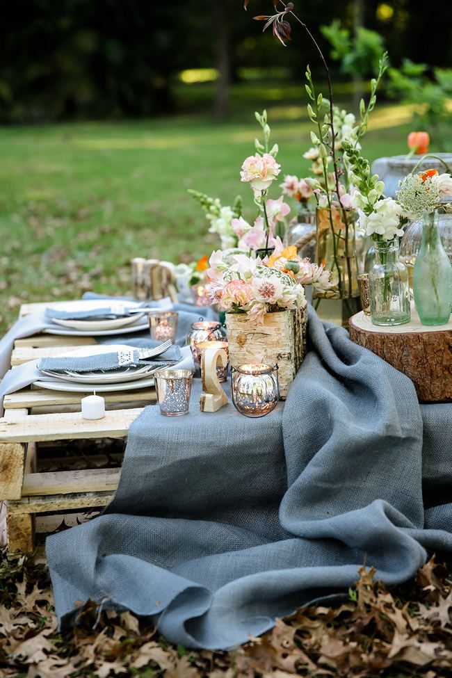 A pretty pallet picnic table filled with rustic decor elements | Rustic Garden Picnic Wedding styled by @confettiddreams // Nikki Meyer Photography